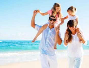 family on beach in florida