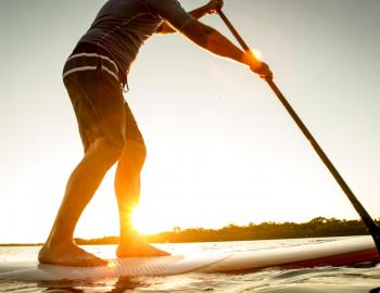 A man stands on a SUP board