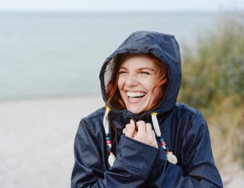 A woman smiles on a 30A rainy day